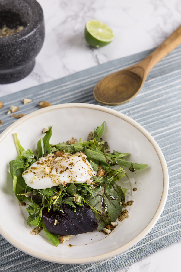 No-vinegar poached egg on a nutrient-packed arugula salad. Velvety runny yolk engulfed by soft silky smooth whites. Easy to make and ready in 10 minutes.