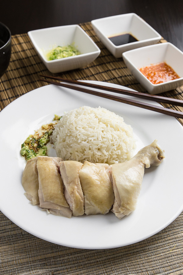 "Make this simplified Hainanese chicken rice recipe at home. Moist Hainan chicken, 3 flavorful sauces, fragrant ""oily rice"". Singaporean classic comfort food."