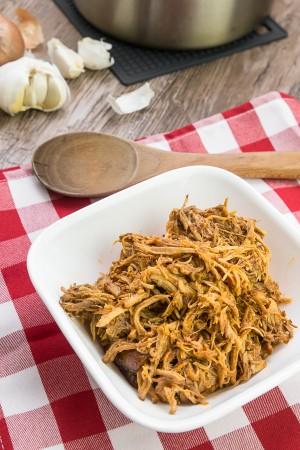 Make your own flavorful dry rub and BBQ sauce with this pulled pork recipe! Mouthful of boldly sweet, salty, and spicy juice ooze out of moist and tender pulled pork. Irresistible! Perfect with sandwiches, wraps, rice, or ANYTHING.