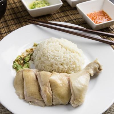 """Make this simplified Hainanese chicken rice recipe at home. Moist Hainan chicken, 3 flavorful sauces, fragrant """"oily rice"""". Singaporean classic comfort food."""